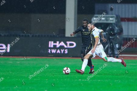 Al-Nassr player Christian Ramos (L) in action for the ball with Ohod player Ahmed Jumaa (R) during the Saudi Professional League soccer match between Al-Nassr and Ohod, at Al-Majmaa City Stadium, Al-Majma'ah, Saudi Arabia, 28 January 2019.