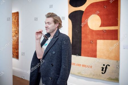Stock Picture of Harland Miller attends a preview for WWF's Tomorrow's Tigers fundraising project at Sotheby's, which is designed to raise awareness and funds in support of the TX2 goal, a global commitment to double tiger numbers in the wild by 2022.
