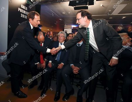 Stock Picture of Spain's former Prime Minister, Mariano Rajoy (R), greets Real Madrid's Institutional Relations Director Emilio Butragueno (L) next to Atletico de Madrid's President, Emilio Cerezo (C) during 2018 Annual Sports Awards gala organized by the Madrid Sports Press Association (APDM) in Madrid, Spain, 28 January 2019.