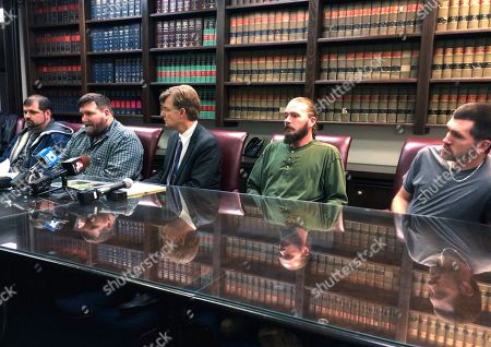 """Robert Hodge, second from left, discusses a family lawsuit over the April 2018 death of his mother, Jeremia """"Sue"""" Hodge, in a news conference with, left to right, brothers Jacob Hodge, Stephen Hodge and Jeremiah Hodge at the Columbus, Ohio, office of attorney David Shroyer, center, on . They say she received a lethal dose of the painkiller fentanyl that was ordered by a Mount Carmel Health System doctor without the family's knowledge"""