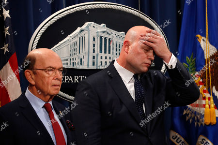 Stock Picture of Wilbur Ross, Matthew Whitaker. Acting Attorney General Matthew Whitaker, right, wipes his brow after announcing an indictment on violations including bank and wire fraud, of Chines telecommunications companies including Huawei, at the Justice Department in Washington. At left is Commerce Secretary Wilbur Ross
