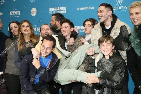 """Jon Cryer, Julia Murney, Emily Arlook, Joseph Vincent Gay, Jason Orley, Griffin Gluck, Thomas Barbusca, Pete Davidson, Aiden Arthur, Colson Baker, Machine Gun Kelly. From left to right, Julia Murney, Emily Arlook, Joseph Vincent Gay, Jason Orley, Griffin Gluck, Thomas Barbusca, Pete Davidson, Aiden Arthur and Colson Baker, aka """"Machine Gun Kelly"""" pose at the premiere of the film """"Big Time Adolescence"""" during the 2019 Sundance Film Festival, in Park City, Utah"""