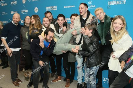 "Jon Cryer, Julia Murney, Emily Arlook, Joseph Vincent Gay, Jason Orley, Griffin Gluck, Thomas Barbusca, Pete Davidson, Aiden Arthur, Colson Baker, Machine Gun Kelly, Sydney Sweeney. From left to right, Jon Cryer, Julia Murney, Emily Arlook, Joseph Vincent Gay, Jason Orley, Griffin Gluck, Thomas Barbusca, Pete Davidson, Aiden Arthur, Colson Baker, aka ""Machine Gun Kelly"" and Sydney Sweeney, pose at the premiere of the film ""Big Time Adolescence"" during the 2019 Sundance Film Festival, in Park City, Utah"