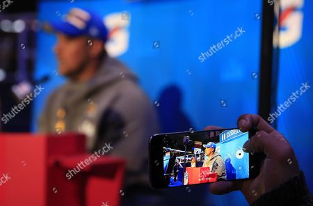 A member of the media shoots video of guard Rodger Saffold as he speaks to the media during the Los Angeles Rams session of the National Football League's Super Bowl LIII Opening Night event at State Farm Arena in Atlanta, Georgia, USA, 28 January 2019. The AFC Champion New England Patriots and the NFC Champion Los Angeles Rams will face off in Super Bowl LIII at Mercedes-Benz Stadium on 03 February 2019.