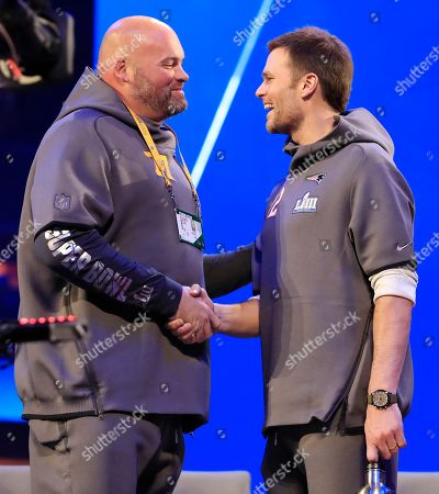Los Angeles Rams offensive tackle Andrew Whitworth (L) and New England Patriots quarterback Tom Brady shake hands between the two sessions of the National Football League's Super Bowl LIII Opening Night event at State Farm Arena in Atlanta, Georgia, USA, 28 January 2019. The AFC Champion New England Patriots and the NFC Champion Los Angeles Rams will face off in Super Bowl LIII at Mercedes-Benz Stadium on 03 February 2019.