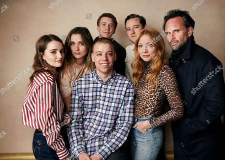 "Stock Photo of Kaitlyn Dever, Alice Englert, Thomas Mann, Lewis Pullman, Walton Goggins, Dan Madison Savage, Britt Poulton. Kaitlyn Dever, from back left, Alice Englert, Thomas Mann, Lewis Pullman, Walton Goggins, director Dan Madison Savage, bottom left, and director Britt Poulton pose for a portrait to promote the film ""Them That Follow"" at the Salesforce Music Lodge during the Sundance Film Festival, in Park City, Utah"