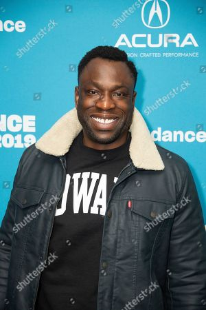 """Cinematographer Hans Charles poses at the premiere of """"Wu-Tang Clan: Of Mics and Men"""" during the 2019 Sundance Film Festival, in Park City, Utah"""