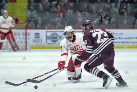 Cornell vs. Colgate Hockey for AP. Cornell's Morgan Barron, left, skates up against Colgate's Jeff Stewart during their game at Cornell University in Ithaca, NY