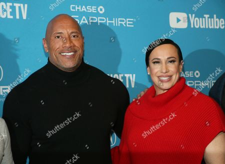 "Stock Photo of Dwayne Johnson, Dany Garcia. Producer and cast member Dwayne Johnson, left, and producer Dany Garcia pose at the premiere of the film ""Fighting With My Family"" during the 2019 Sundance Film Festival, in Park City, Utah"
