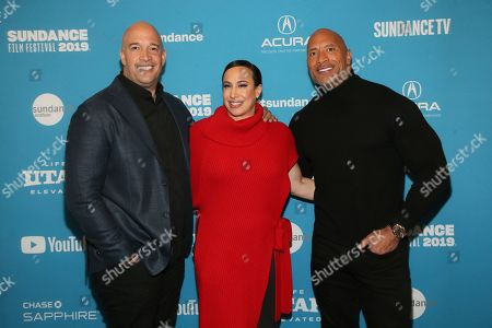 "Hiram Garcia, Dany Garcia, Dwayne Johnson. From left to right, executive producer Hiram Garcia, producer Dany Garcia, and cast member and producer Dwayne Johnson pose at the premiere of the film ""Fighting With My Family"" during the 2019 Sundance Film Festival, in Park City, Utah"