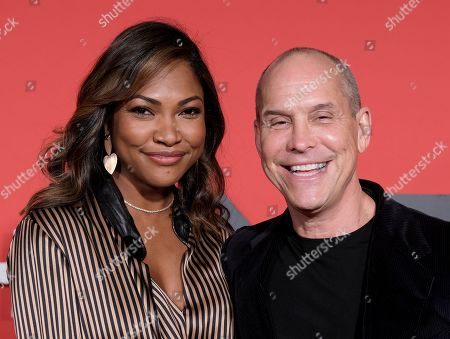 Stock Picture of Tracy James and Brian Robbins