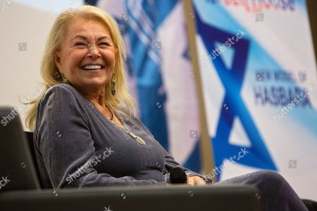 American actress Roseanne Barr sits during a conference at the Menachem Begin Heritage Center in Jerusalem. Comedian and divisive former television star Barr says her sitcom was canceled last year because of backlash against her support for Israel