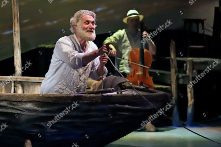 Actor Anthony Crivello, left, plays the roll of Santiago with cellist Simon Cummings, in a stage adaptation of Ernest Hemingway's Old Man and the Sea during a dress rehearsal at the Pittsburgh Playhouse in Pittsburgh . The stage version was written by journalist and playwright AE Hotchner, the writer's confidant and fishing companion in Cuba during the period in which the novella was written, and his son Tim Hotchner