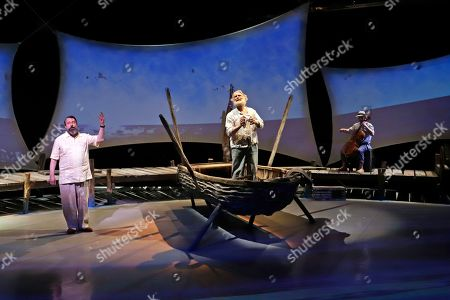 Actor Anthony Crivello, center, plays the roll of Santiago with cellist Simon Cummings, right and David Cabot, as Ernest Hemingway, in a stage adaptation of Ernest Hemingway's Old Man and the Sea during a dress rehearsal at the Pittsburgh Playhouse in Pittsburgh . The stage version was written by journalist and playwright AE Hotchner, the writer's confidant and fishing companion in Cuba during the period in which the novella was written, and his son Tim Hotchner