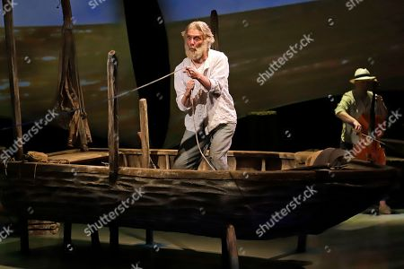 Stock Picture of Actor Anthony Crivello, center, plays the roll of Santiago with cellist Simon Cummings, in a stage adaptation of Ernest Hemingway's Old Man and the Sea during a dress rehearsal at the Pittsburgh Playhouse in Pittsburgh . The stage version was written by journalist and playwright AE Hotchner, the writer's confidant and fishing companion in Cuba during the period in which the novella was written, and his son Tim Hotchner