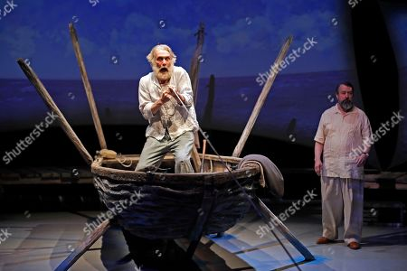 Stock Image of Actor Anthony Crivello, left, plays the roll of Santiago with David Cabot as Ernest Hemmingway, in a stage adaptation of Ernest Hemingway's Old Man and the Sea during a dress rehearsal at the Pittsburgh Playhouse in Pittsburgh . The stage version was written by journalist and playwright AE Hotchner, the writer's confidant and fishing companion in Cuba during the period in which the novella was written, and his son Tim Hotchner
