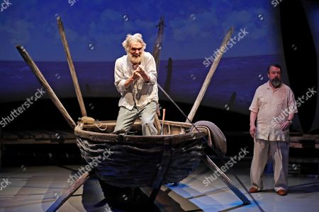 Actor Anthony Crivello, left, plays the roll of Santiago with David Cabot as Ernest Hemmingway, in a stage adaptation of Ernest Hemingway's Old Man and the Sea during a dress rehearsal at the Pittsburgh Playhouse in Pittsburgh . The stage version was written by journalist and playwright AE Hotchner, the writer's confidant and fishing companion in Cuba during the period in which the novella was written, and his son Tim Hotchner