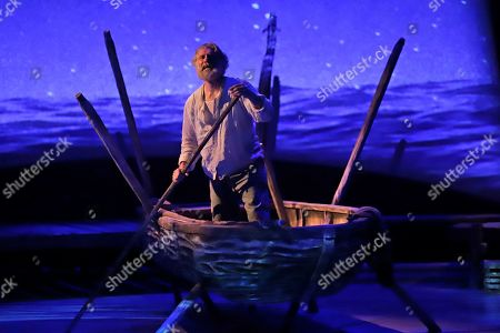 "Stock Photo of Actor Anthony Crivello plays the role of Santiago in a stage adaptation of Ernest Hemingway's ""The Old Man and the Sea"" during a dress rehearsal at the Pittsburgh Playhouse in Pittsburgh. The stage version was written by journalist and playwright A.E. Hotchner, the writer's confidant and fishing companion in Cuba during the period in which the novella was written, and his son Tim Hotchner"