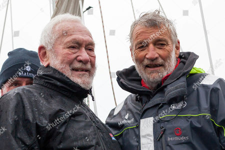 Stock Picture of French sailor Jean-Luc Van Den Heede, 73, right, aboard his Rustler 36, Matmut, poses with legendary sailor Sir Robin Knox-Johnston of Britain, after winning the Golden Globe Race, a single-handed round the world yacht race, after 212 days alone at sea, in Les Sables-d'Olonne harbor, western France
