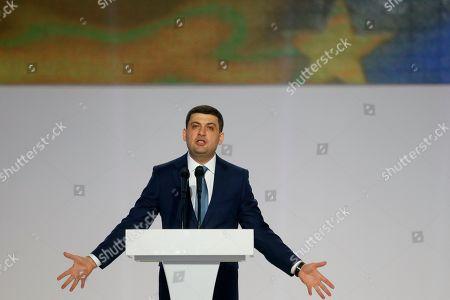 Ukrainian Prime Minister Volodymyr Groysman speaks at a meeting of Ukrainian President Petro Poroshenko's supporters in Kiev, Ukraine, . Poroshenko declared his intention to run for re-election in March's presidential vote