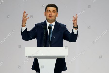 Ukrainian Prime Minister Volodymyr Groysman gestures as he speaks at a meeting of Ukrainian President Petro Poroshenko's supporters in Kiev, Ukraine, . Poroshenko declared his intention to run for re-election in March's presidential vote