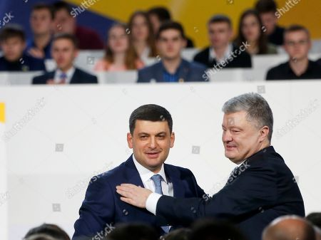 Petro Poroshenko, Volodymyr Groysman. Ukrainian President Petro Poroshenko, right, and Ukrainian Prime Minister Volodymyr Groysman greet each other at a meeting with supporters in Kiev, Ukraine, . Poroshenko declared his intention to run for re-election in March's presidential vote