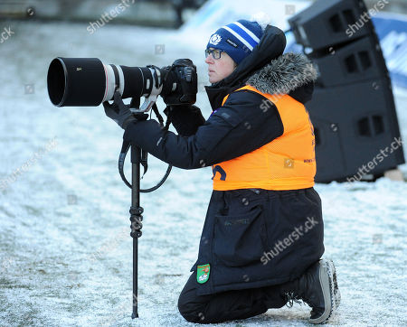 Sports photographer Lynn Cameron works in the freezing cold winter conditions.