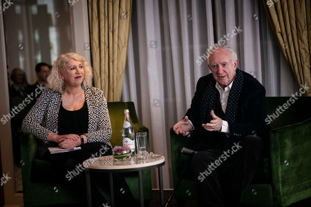 Stock Photo of Jonathan Pryce in conversation with Anne Morrison