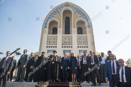 French President Emmanuel Macron and Brigitte Trogneux with His Holiness Tawadros II (Theodore II), Coptic Orthodox Pope during a visit to the Coptic cathedral in Cairo