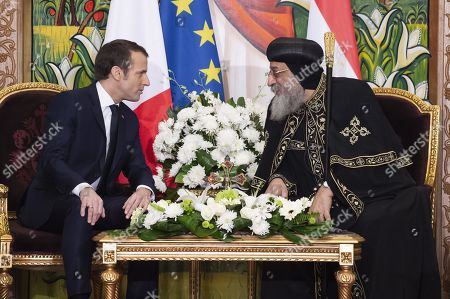 French President Emmanuel Macron speaks with His Holiness Tawadros II (Theodore II), Coptic Orthodox Pope during a state visit in Cairo