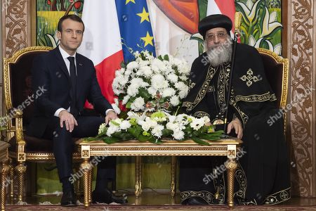 Stock Photo of French President Emmanuel Macron speaks with His Holiness Tawadros II (Theodore II), Coptic Orthodox Pope during a state visit in Cairo