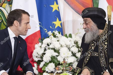 Stock Image of French President Emmanuel Macron speaks with His Holiness Tawadros II (Theodore II), Coptic Orthodox Pope during a state visit in Cairo