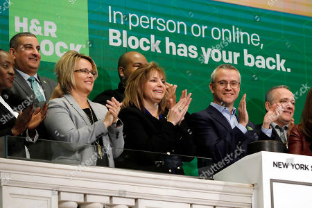 Stock Photo of H&R Block President & CEO Jeffrey J. Jones II, foreground right, joins the applause as he tings the New York Stock Exchange opening bell