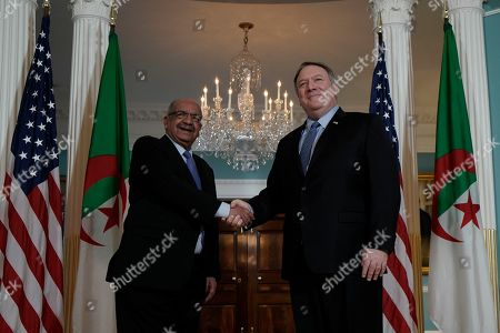 Secretary of State Mike Pompeo, right, shakes hands with Algerian Foreign Minister Abdelkader Messahel, at the State Department in Washington