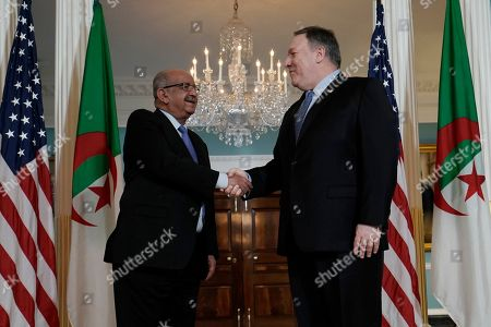 Secretary of State Mike Pompeo, right, shakes hands with Algerian Foreign Minister Abdelkader Messahel, at the Department of State in Washington