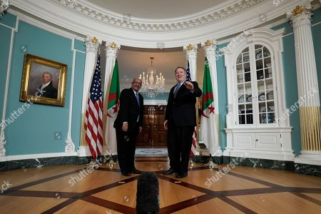 Secretary of State Mike Pompeo, right, gestures at his meeting with Algerian Foreign Minister Abdelkader Messahel, at the Department of State in Washington