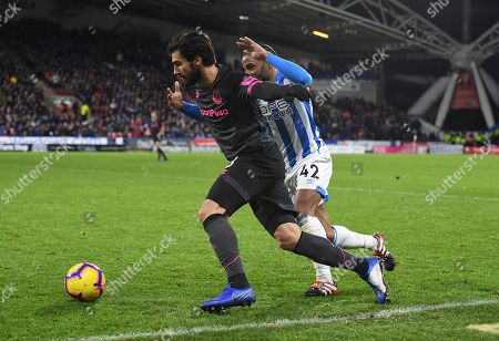 Andre Gomes of Everton and Jason Puncheon of Huddersfield Town