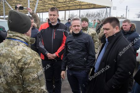 Ukrainian Foreign Minister Pavlo Klimkin (R) speaks with Czech Foreign Minister Tomas Petricek (C-L), Danish Foreign Minister Anders Samuelsen (C-R), during their meeting in the Gnutove village not far from the eastern-Ukrainian city of Mariupol, Ukraine, 29 January 2019. Tomas Petricek and Anders Samuelsen visit eastern-Ukrainian conflict zone during their working visit for understanding the situation in the area.