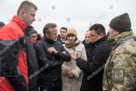 Ukrainian Foreign Minister Pavlo Klimkin (2-R) speaks with Czech Foreign Minister Tomas Petricek (L), Danish Foreign Minister Anders Samuelsen (2-L), during their meeting in the Azov sea port in the eastern-Ukrainian city of Mariupol, Ukraine, 29 January 2019. Tomas Petricek and Anders Samuelsen visit eastern-Ukrainian conflict zone during their working visit for understanding the situation in the area.