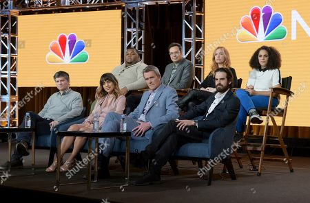 """Michael Schur, Natalie Morales, Neil flynn, Josh Malmuth, Leonard Ouzts, Nelson Franklin, Jessica Chaffin, Kimia Behpoornia. Executive producer Michael Schur, from front row left, Natalie Morales, Neil Flynn, executive producer Josh Malmuth, and from back row left, Leonard Ouzts, Nelson Franklin, Jessica Chaffin and Kimia Behpoornia participate in NBC's """"Abby's"""" panel during the NBCUniversal TCA Winter Press Tour, in Pasadena, Calif"""