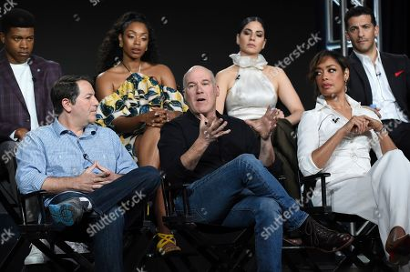 "Aaron Korsh, Daniel Arkin, Gina Torres, Eli Goree, Chantel Riley, Isabel Arraiza, Simon Kassianides. Executive producer Aaron Korsh, from front row left, executive producer/showrunner Daniel Arkin, co-executive producer Gina Torres, and from back row left, Eli Goree, Chantel Riley, Isabel Arraiza and Simon Kassianides participate in USA's ""Pearson"" panel during the NBCUniversal TCA Winter Press Tour, in Pasadena, Calif"