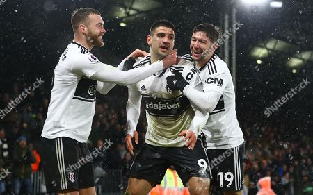 Aleksander Mitrovic of Fulham celebrates scoring a goal to make the score 2-2 with fellow goalscorers Calum Chambers and Luciano Vietto