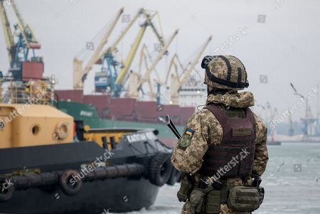 Armed Ukrainian soldier guards the Azov sea port in the eastern-Ukrainian city of Mariupol, Ukraine, 29 January 2019. Czech Foreign Minister Tomas Petricek and Danish Foreign Minister Anders Samuelsen visit eastern-Ukrainian conflict zone during their working visit for understanding the situation in the area.