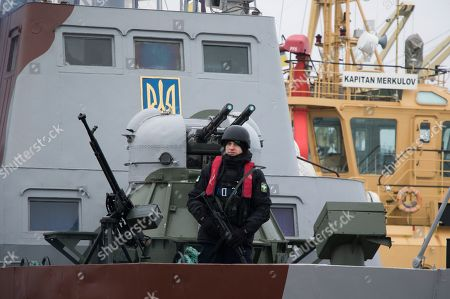 Armed Ukrainian sailor guards on the armored artillery patrol boat in the Azov sea port in the eastern-Ukrainian city of Mariupol, Ukraine, 29 January 2019. Czech Foreign Minister Tomas Petricek and Danish Foreign Minister Anders Samuelsen visit eastern-Ukrainian conflict zone during their working visit for understanding the situation in the area.