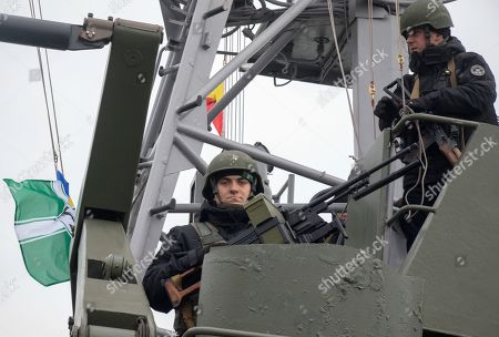 Armed Ukrainian sailors guard on the armored artillery patrol boat in the Azov sea port in the eastern-Ukrainian city of Mariupol, Ukraine, 29 January 2019. Czech Foreign Minister Tomas Petricek and Danish Foreign Minister Anders Samuelsen visit eastern-Ukrainian conflict zone during their working visit for understanding the situation in the area.