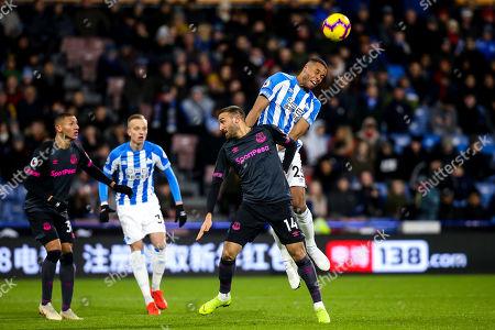 Mathias Zanka Jorgensen of Huddersfield Town beats Cenk Tosun of Everton to a header
