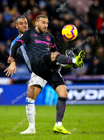 Cenk Tosun of Everton takes on Mathias Zanka Jorgensen of Huddersfield Town