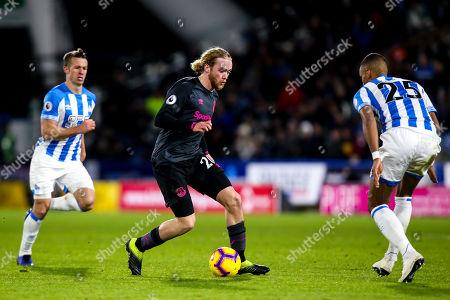 Tom Davies of Everton takes on Mathias Zanka Jorgensen of Huddersfield Town