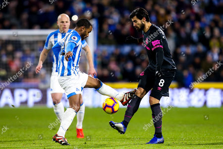 Andre Gomes of Everton is caught by Jason Puncheon of Huddersfield Town