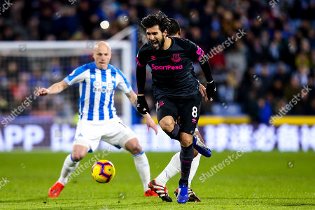 Andre Gomes of Everton looks in pain after being caught by Jason Puncheon of Huddersfield Town